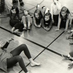 """Linda Putnam as a turtle interacts with children in the participatory audience in Queen of the Beasts, dramatized to the music """"Carnival of the Animals."""""""